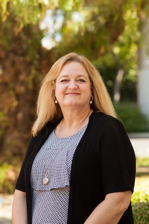 Addiction Recovery - Pam Didier smiling outside