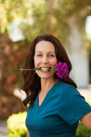 Addiction Recovery - A smiling image of Rebecca Allen the Office Manager
